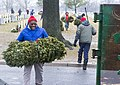 Wreath cleanup event, Justice Thomas carrying wreaths (16355647855).jpg
