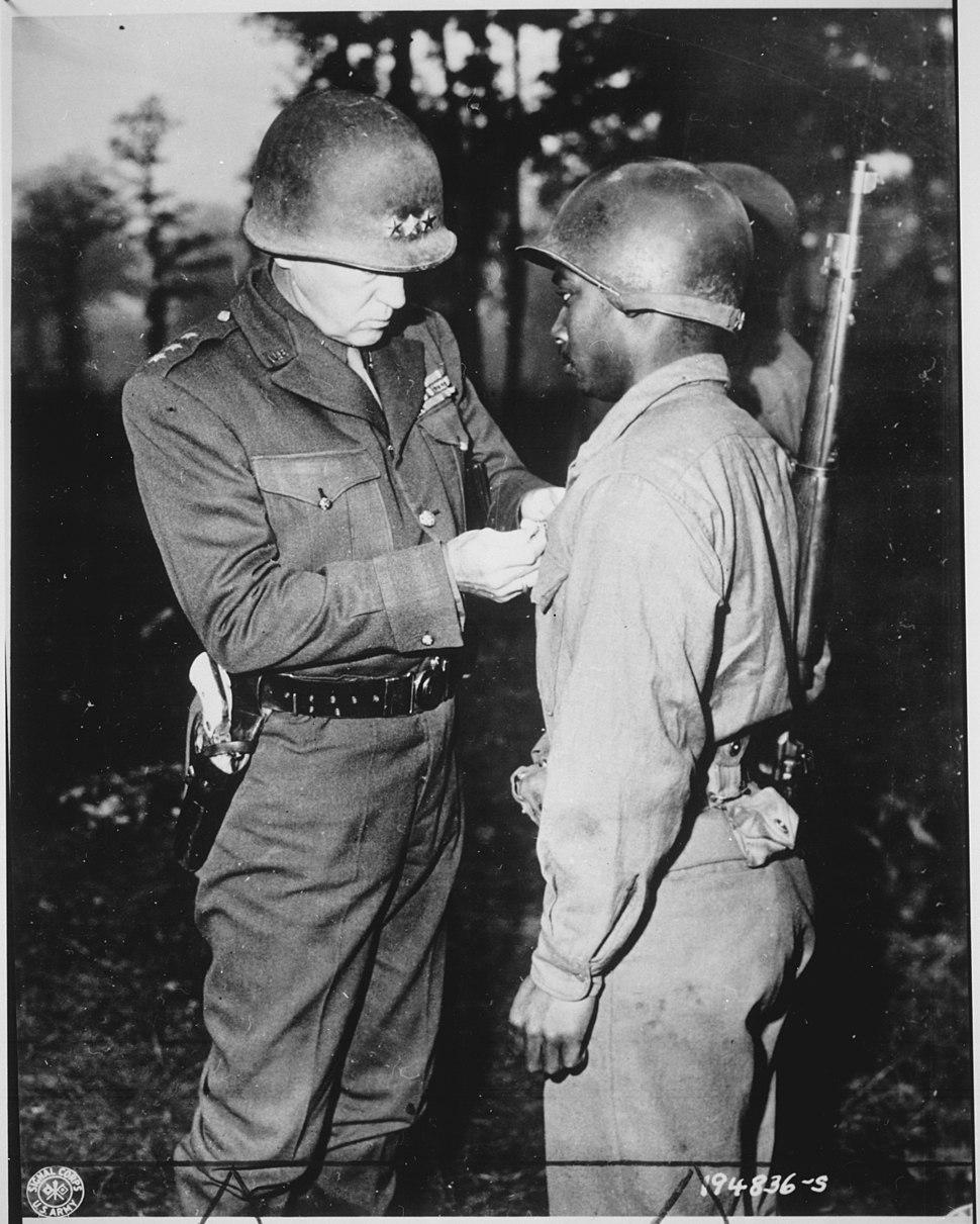 """""""Lt. Gen. George S. Patton, U.S. Third Army commander, pins the Silver Star on Private Ernest A. Jenkins of New York Cit - NARA - 535724"""