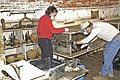 (Hurricane Katrina) Fort Jackson, LA, 11-01-05 -- These workers are trying to salvage artifacts from display cases at the Fort Jackson historical museum. Hurricane Katrina left 10 f - DPLA - 84d4e36028ff15f02aaa30679d6fbc56.jpg