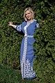 День Вишиванки. Молода україночка у вишитій синій сукні серед квітів 11.jpg