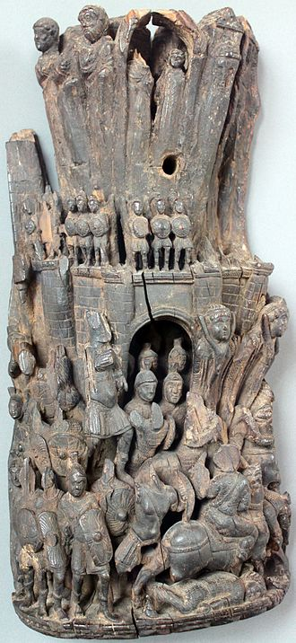 Roman army - Stone-carved relief depicting the liberation of a besieged city by a relief force, with those defending the walls making a sortie (i.e. a sudden attack against a besieging enemy from within the besieged town); Western Roman Empire, early 5th Century AD
