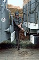 103 Le chauffeur Calvat (c'est son vrai nom) du 511e serre l'unique corde qui tiendra son chargement. (4060508521).jpg