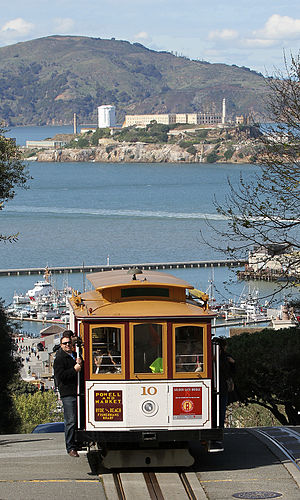 San Francisco cable car system - Cable Car No. 10 with Alcatraz Island in the background