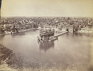 Golden Temple - A 1880 photograph of the Golden Temple, sacred pool and the nearby buildings. The walled courtyard and entrances were added later.