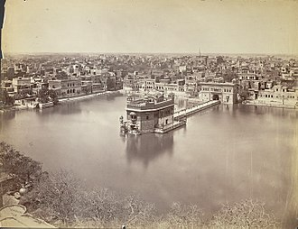 Golden Temple - An 1880 photograph of the Golden Temple, sacred pool and the nearby buildings. The walled courtyard and entrances were added later.