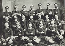 Photo of a group of rugby players posing in their uniforms.