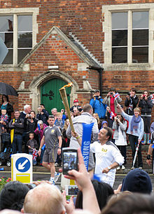 2012 torch relay day 52 Raymond Blanc brings the torch into Wallingford (7663002978).jpg