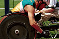 241000 - Athletics wheelchair racing 5km T52 final Greg Smith gold action - 3b - 2000 Sydney race photo.jpg
