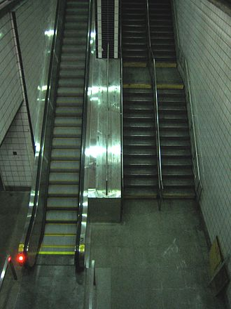 50th Street (IND Eighth Avenue Line) - Escalator from the lower level southbound platform