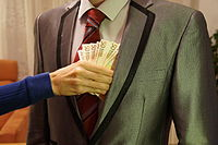 6 - man in suit holding with woman's hand reaching to take 50 euro banknotes - royalty free, without copyright, public domain photo image.JPG