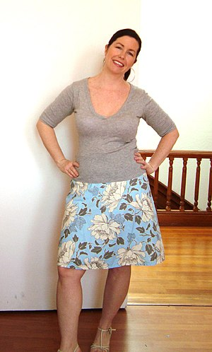 A-line (clothing) - A woman wearing an A-line skirt.