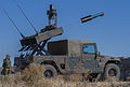 A Japan Ground Self-Defense Force Type 96 multi-purpose missile system fires a Tube-launched Optically-tracked Wire-guided missile in a demonstration during Operation Rising Thunder 2014, at Yakima Training 140905-A-BX700-548.jpg
