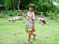 A Katang girl in Laos carries firewood.jpg