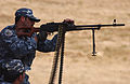 A Kurdish Peshmerga officer fires a PKM in Mosul,.jpg