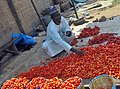 A Nigerian Tomatoes seller on the roadside in Ilorin2.jpg