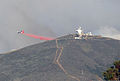 A P-2 Neptune aircraft drops fire retardant during the Springs Fire in Point Mugu State Park, Calif., May 2, 2013 130502-D-QK571-121.jpg