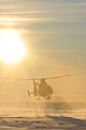 A U.S. Coast Guard MH-65 Dolphin helicopter crew lands on an ice sheet near Nome, Alaska, Jan 120118-G-ZQ587-002.jpg