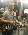 Adam George with his replica Stevie Ray Vaughan 1 Guitar.jpg