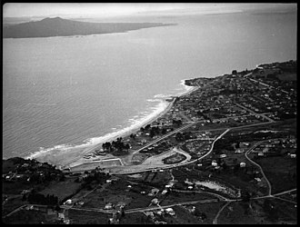 Milford, New Zealand - Aerial view of Milford, with Rangitoto Island, ca. 1920s-1940s
