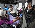 Aircrewman comforts an evacuee following the landfall of Hurricane Maria. (37331284731).jpg