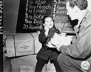 American charity worker and Jewish refugee child (Vienna, ca. 1945).jpg