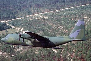 An Air Force Reserve C-130 Hercules transport aircraft approaches a drop zone during the Airlift Rodeo '90 container delivery system phase DF-ST-92-06090.jpg