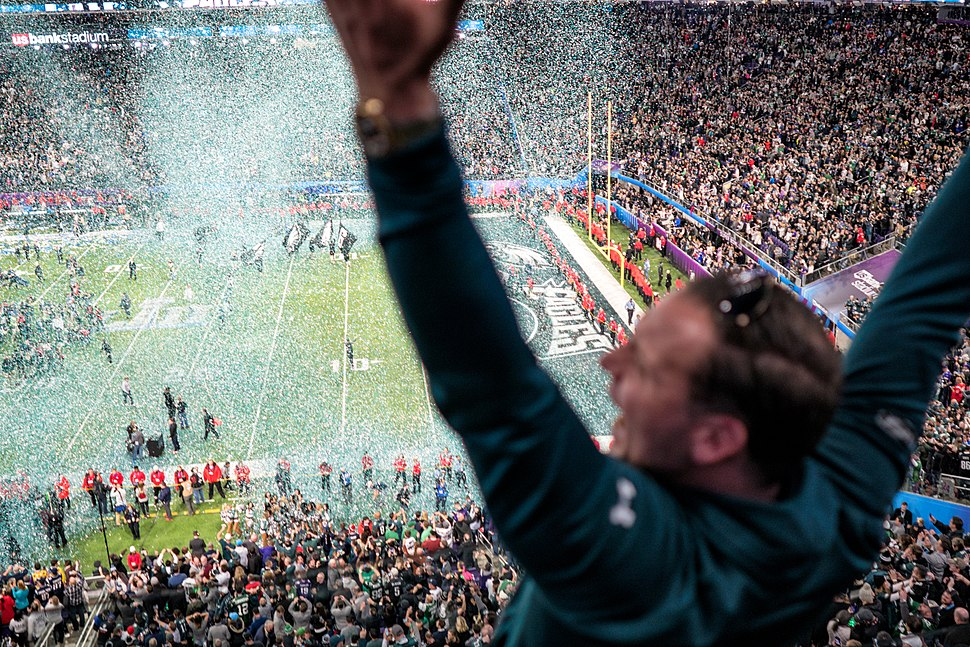 An Eagles fan celebrates as confetti falls on the field at Super Bowl 2018, Minneapolis MN (40074198602)
