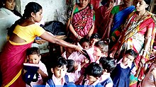 Anganwadi Worker AWW Distributing Dresses to childrens