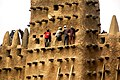 Annual repair of the world's largest mud brick building the Great Mosque of Djenné in Mali. (32088227574).jpg