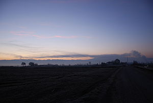 Anthropogenic cloud - Stratus homogenitus (Sth) formed due to the emissions of a dairy factory near Gurb (Spain, February 2011).