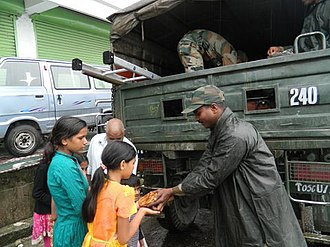 2011 Sikkim earthquake - Army personnel distributing relief material to the people in earthquake affected area of Sikkim