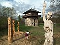 Art statues in front of a reconstruction of a watchtower on the German Limes wall - panoramio.jpg
