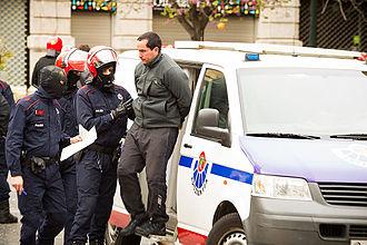 Ertzaintza - Ertzainas effecting an arrest
