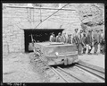 At this mine the motor hauling the man trip is stopped just after it emerges from mine portal. The men then get out... - NARA - 540923.tif