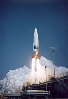 A rocket takes off from the launch pad.