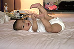 Baby holding feet.jpg