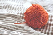 Ball of orange yarn (Unsplash).jpg