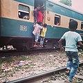 Bangladeshi child's risky climbing on train.jpg
