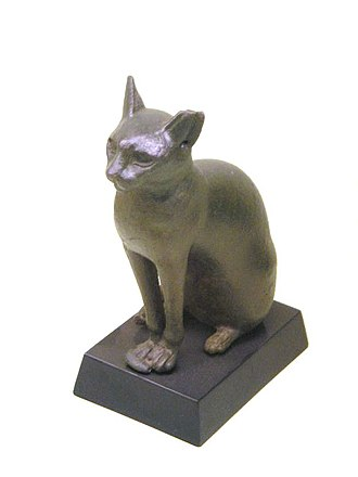 Cat - Ancient Egyptian sculpture of the cat goddess Bastet. The earliest evidence of felines as Egyptian deities comes from a c. 3100 BC.