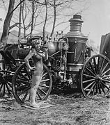 Bea Kyle Standing Fire Engine and Pickle 1924, edited.jpg