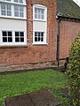 Bench mark under the window - geograph.org.uk - 1728298.jpg