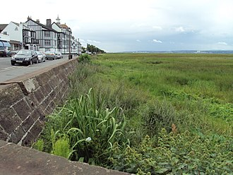 Parkgate, Cheshire - View showing marsh, sea wall, and Mostyn House School