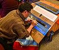 Bhutanese calligrapher writing gold Kangyur.jpg