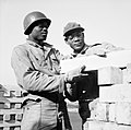 Black American soldiers engaged in railway construction work in Britain, 7 October 1943. H33450.jpg