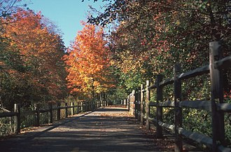 Rhode Island - The Blackstone River Greenway in autumn, approximately one mile (1.6 km) south of the Martin St. Bridge