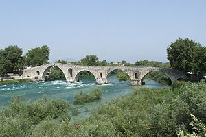 Water supply and sanitation in Greece - The town of Arta discharges its wastewater in an ecologically sensitive area in the lower reaches of the Arachtos river (shown here with the famous Arta bridge)