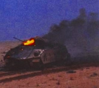 Battle of 73 Easting - Wrecked Bradley IFV K-12 burns after being hit by Iraqi tank fire during the first stages of the battle