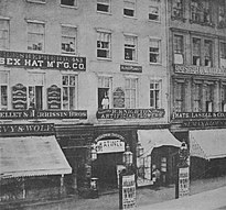 "Photo of 483, 485, and 487 Broadway, with the entrance to, and name of, the Broadway Theatre; a sign reading ""Matinee""; and posters announcing Julia Dean in The Woman in White. Also visible are signboards of H. F. Shepher (Essex Hat Manufacturing Co.) at 483, H. Knighton and Alfred Plunkett at 485, and Lasell & Co. (hats) at 487."