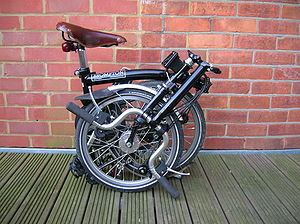 Folding bicycle - Folded Brompton, side view