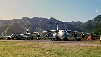Military Airlift Command - A Military Airlift Command C-141A at Pago Pago International Airport in July 1968. The aircraft behind the C-141 is an Air New Zealand DC-8.